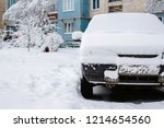 parked car covered with snow  ... | Shutterstock . vector #1214654560
