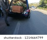 funeral car with coffin | Shutterstock . vector #1214664799
