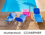 sunbeds by a swimming pool in...   Shutterstock . vector #1214689489