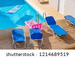 sunbeds by a swimming pool in... | Shutterstock . vector #1214689519