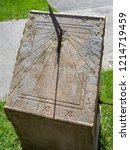 Old Stone Sundial With Roman...