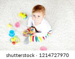 adorable baby girl playing with ... | Shutterstock . vector #1214727970