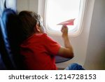 little kid boy playing with red ... | Shutterstock . vector #1214728153