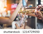 the female bartender is pouring ... | Shutterstock . vector #1214729050