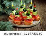 christmas canape on skewer from ...   Shutterstock . vector #1214733160
