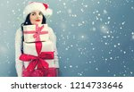 young woman with santa hat... | Shutterstock . vector #1214733646