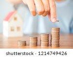saving money concept man hand... | Shutterstock . vector #1214749426