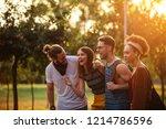 cropped shot of four joyful... | Shutterstock . vector #1214786596