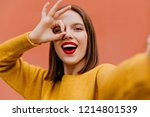 dark eyed white lady wears... | Shutterstock . vector #1214801539
