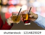 friends toasting glasses in a... | Shutterstock . vector #1214825029