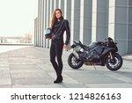 a beautiful biker girl holding... | Shutterstock . vector #1214826163