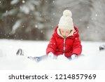 adorable little girl having fun ... | Shutterstock . vector #1214857969