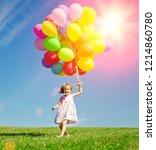 happy little girl holding...   Shutterstock . vector #1214860780