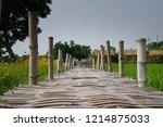 rice field and wooden bridge in ... | Shutterstock . vector #1214875033
