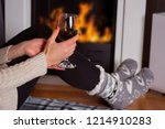 woman holds glass with red wine ... | Shutterstock . vector #1214910283