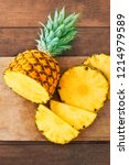 pineapple on wood texture... | Shutterstock . vector #1214979589