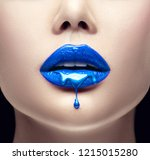 lipstick. blue paint drips from ... | Shutterstock . vector #1215015280