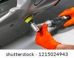 car polish wax worker hands... | Shutterstock . vector #1215024943