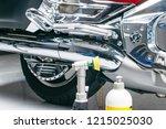 car polish wax worker hands... | Shutterstock . vector #1215025030