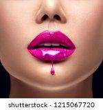 pink lipstick dripping. paint... | Shutterstock . vector #1215067720