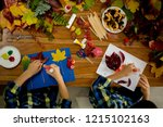 children  applying leaves using ... | Shutterstock . vector #1215102163