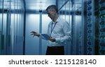 medium shot of technician... | Shutterstock . vector #1215128140