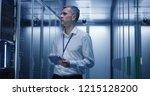 medium shot of technician... | Shutterstock . vector #1215128200