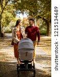 happy young parents walking in... | Shutterstock . vector #1215134689