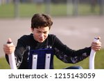 teenager boy training arm... | Shutterstock . vector #1215143059