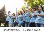 group of happy volunteers... | Shutterstock . vector #1215144616