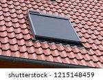 roof window with roller shutter | Shutterstock . vector #1215148459