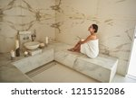 cheerful dark haired slim lady... | Shutterstock . vector #1215152086