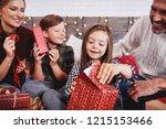 children opening christmas... | Shutterstock . vector #1215153466