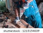 home workshop. man builder in... | Shutterstock . vector #1215154039