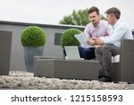 two attractive business man... | Shutterstock . vector #1215158593