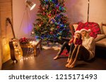 child with mom near christmas... | Shutterstock . vector #1215171493