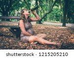 Pregnant Woman Drinking Wine I...