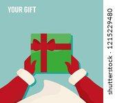 santa hand giving a gift box   Shutterstock .eps vector #1215229480