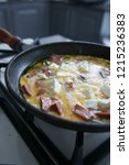 eggs cooking in a pan with feta ... | Shutterstock . vector #1215236383