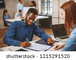 young black man in a job... | Shutterstock . vector #1215291520