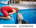 woman kissing with beluga ... | Shutterstock . vector #1215302236