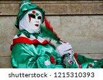 carnival green white red mask... | Shutterstock . vector #1215310393