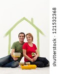 Couple in their new home preparing to redecorate with painting utensils - stock photo