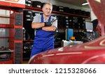 pensive elderly man mechanic... | Shutterstock . vector #1215328066