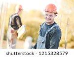 construction worker at building ... | Shutterstock . vector #1215328579