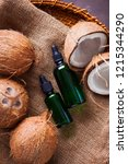 coconut oil with coconuts  ...   Shutterstock . vector #1215344290