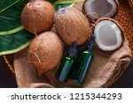 coconut oil with coconuts  ...   Shutterstock . vector #1215344293