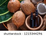 coconut oil with coconuts  ...   Shutterstock . vector #1215344296