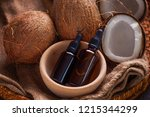 coconut oil with coconuts  ...   Shutterstock . vector #1215344299