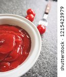 ketchup tomato sauce on stone... | Shutterstock . vector #1215423979